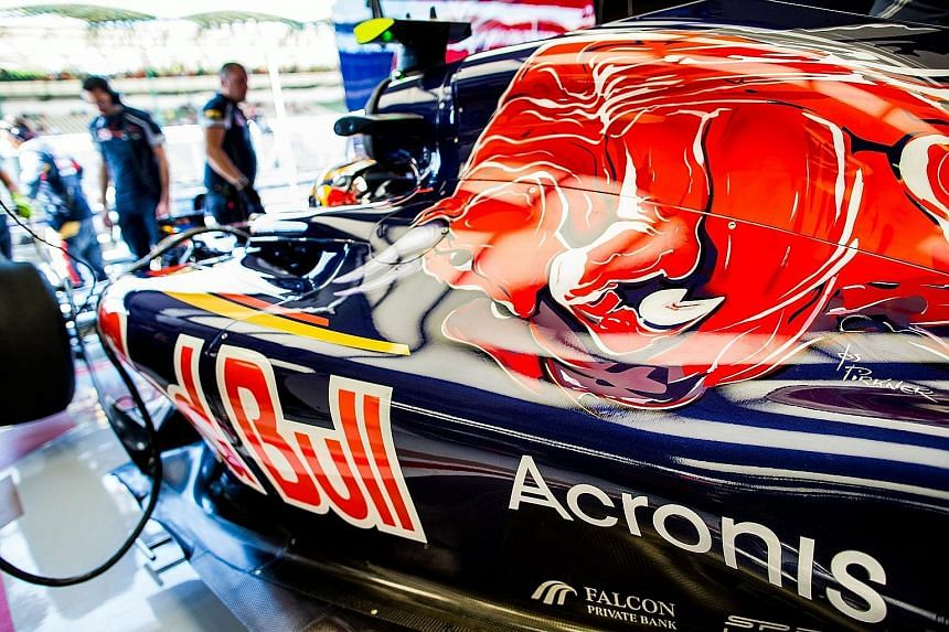 The logo of Acronis, a Singapore-based data back-up and protection company with offices around the world, emblazoned on the cars of Scuderia Toro Rosso. The Acronis-STR deal is a multi-year sponsorship.