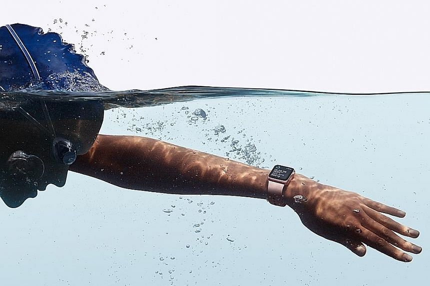 Above left: The Apple Watch Series 2 has a rectangular face and is similar to its predecessor in design. Above: The watch can track your pool and open-water swims, but it is not meant to be used for diving.