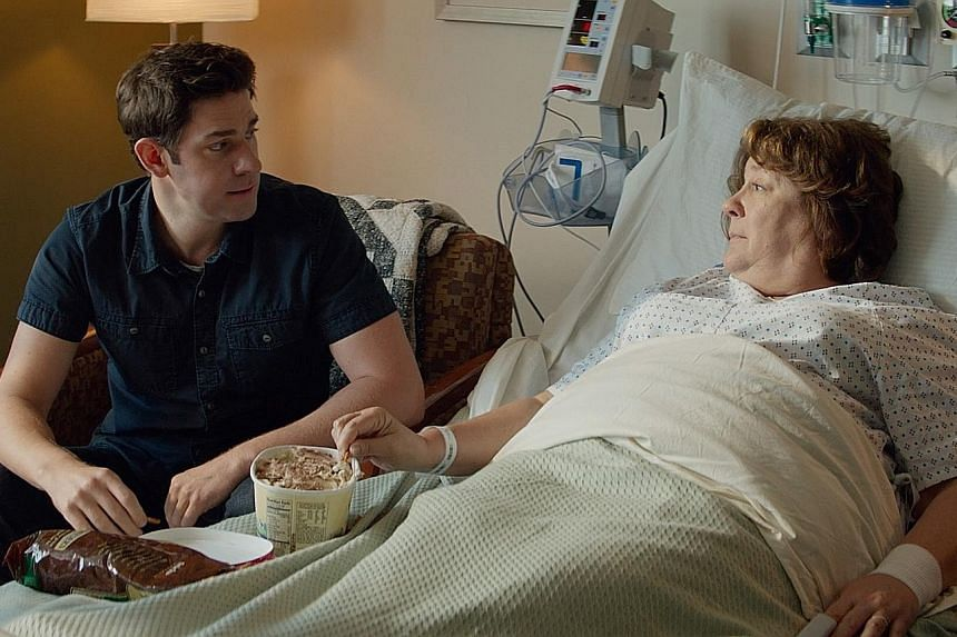 In The Hollars, John Krasinski (left) plays a graphic novelist whose mother (Margo Martindale, right) has a brain tumour.