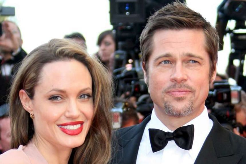 Brad Pitt and Angelina Jolie arriving for the gala screening of Inglourious Basterds in Cannes, France, in May 2009.