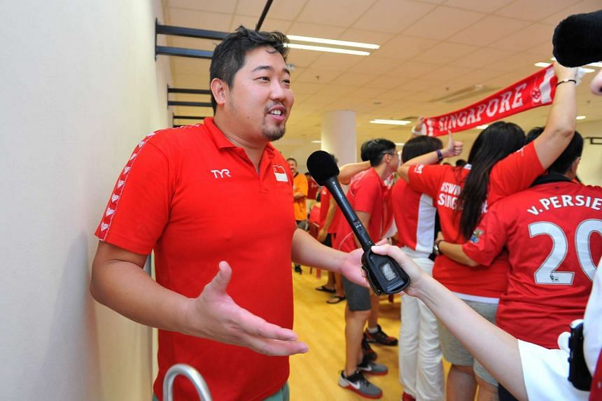 Assistant national swim coach Gary Tan speaking to media at the OCBC Aquatic Centre during a screening of Joseph Schooling's 100m butterfly race at the Rio Olympics on Aug 13, 2016.