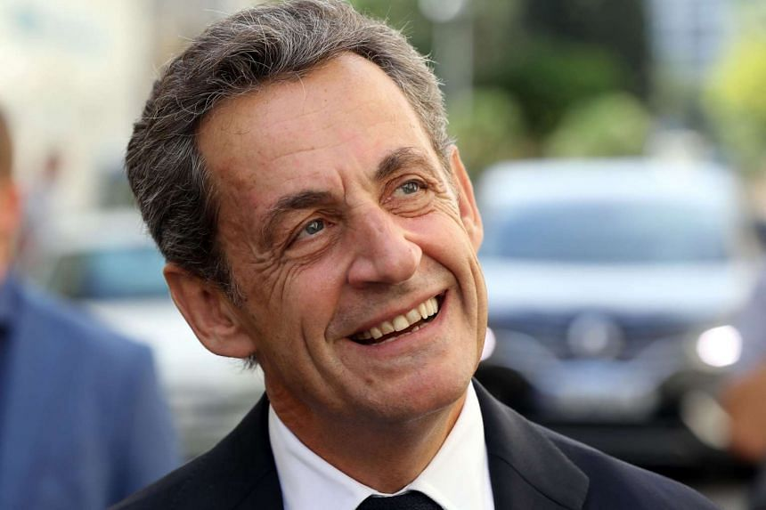 Nicolas Sarkozy, former French president and candidate for the right-wing Les Republicains (LR) party primary, smiles ahead of the 2017 presidential election.