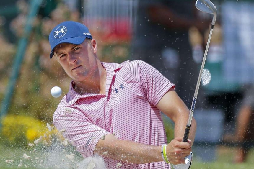 Jordan Spieth of the USA hits from a bunker on the putting green during a practice round for the Tour Championship golf tournament at the East Lake Golf Club in Atlanta, Georgia, USA on Sept 20, 2016.