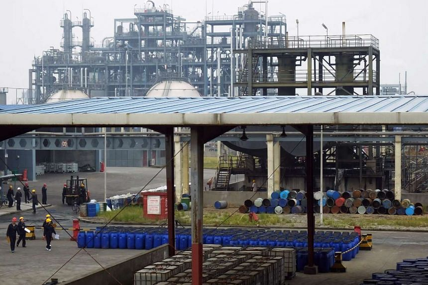Chinese workers walking across the grounds at a chemical factory in Yichang, central China's Hubei province.