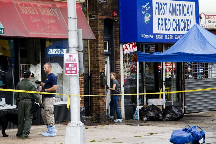 FBI investigators gather evidence at First American Fried Chicken, owned by the family of Ahmad Khan Rahami in Elizabeth, New Jersey on Sept 19, 2016.