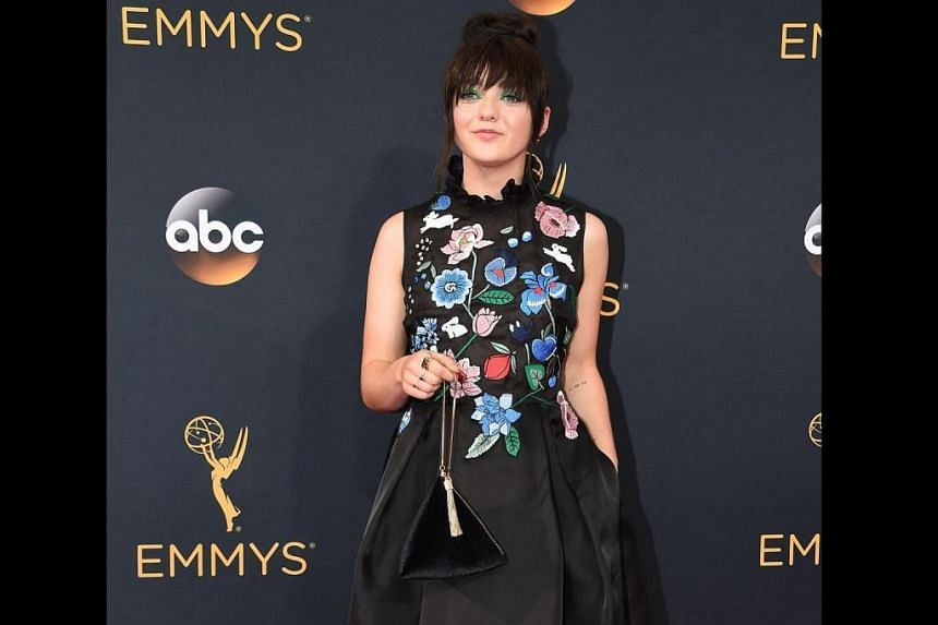 Maisie Williams on the red carpet of the 68th Emmy Awards carrying a S$39.90 Charles & Keith bag on Sept 18, 2016.