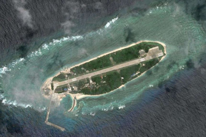 Four three-pronged structures sit in a semi-circle just off the northwestern shoreline of Itu Aba, across from an upgraded airstrip and recently constructed port that can dock 3,000-ton frigates.