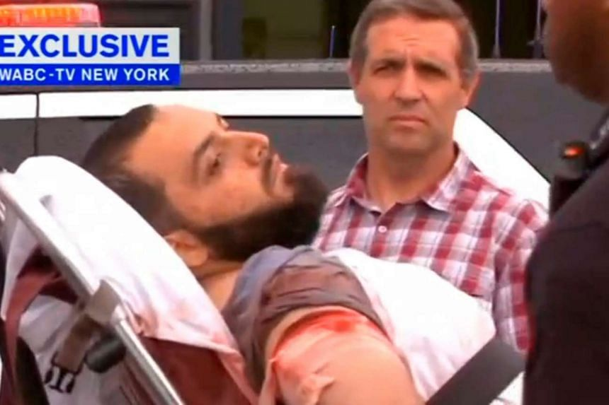 A conscious man believed to be New York bombing suspect Ahmad Khan Rahami is loaded into an ambulance after a shoot-out with police in New Jersey on Sept 19, 2016.