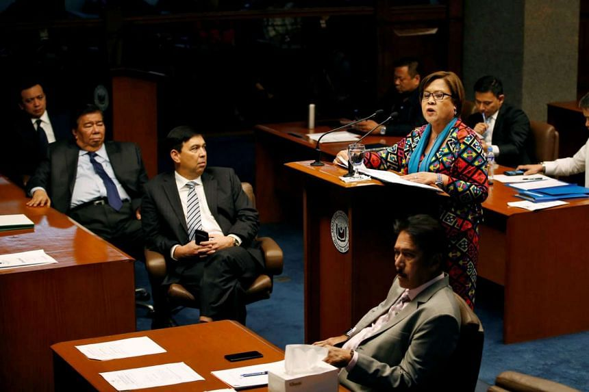 Philippine Senator Leila de Lima delivering a privilege speech in the Senate yesterday. She claimed the witnesses from the penitentiary had been coerced into testifying against her.