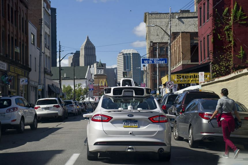 An Uber self-driving Ford Fusion in Pittsburgh, where the ride-hailing giant began trials last week to let loyal customers order rides from driverless cars via their smartphone app.