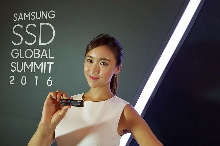 A model showing off the new Samsung 960 PRO SSD during its annual SSD Summit in Seoul.