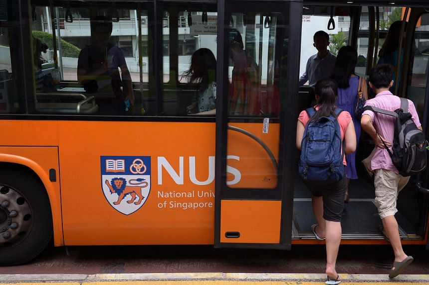 National University of Singapore (NUS) students boarding the campus shuttle bus.