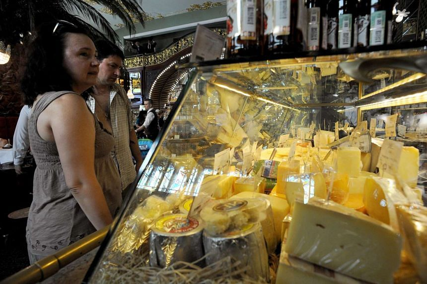 A woman buys cheese at a supermarket in Saint Petersburg, Russia.
