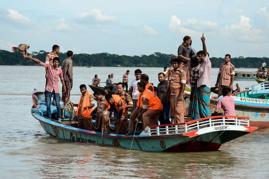 Rescue workers looking for survivors after a ferry sank in the southern district of Barisal, Bangladesh, on Sept 21, 2016.