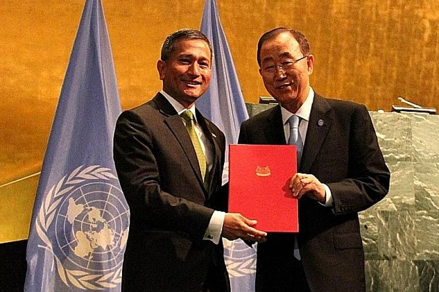 Dr Balakrishnan with UN Secretary-General Ban Ki Moon. Singapore's instrument of ratification was submitted yesterday.