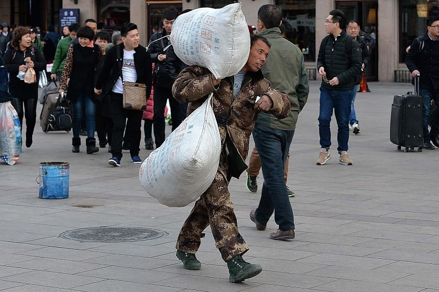 A migrant worker at Beijing Railway Station. China aims to have 60 per cent of its population living in cities by 2020.