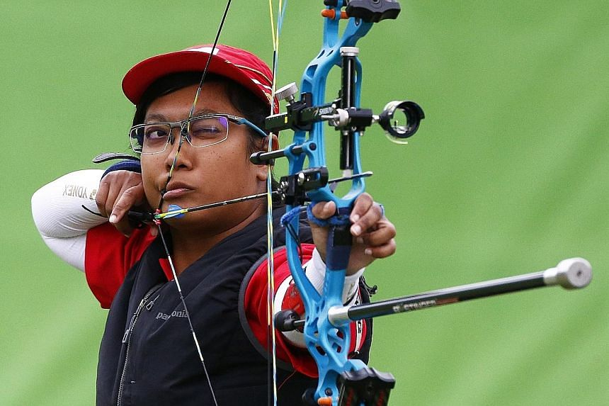 Singapore's Nur Syahidah Alim shooting during the individual compound event in Rio. The para-archer shrugged off the loss of her shooting stool to reach the quarter-finals.