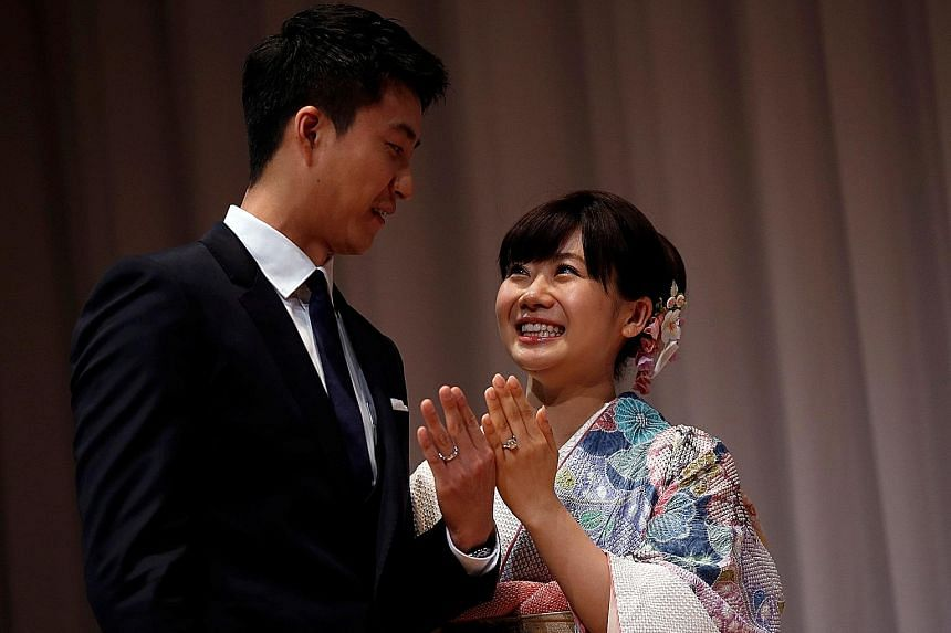 Japanese star Ai Fukuhara and husband Chiang Hung-chieh showing off their custom-made wedding rings, engraved with table tennis balls, at a news conference in Tokyo to announce their marriage. Chiang, her fellow Rio Olympian from Chinese Taipei, desi