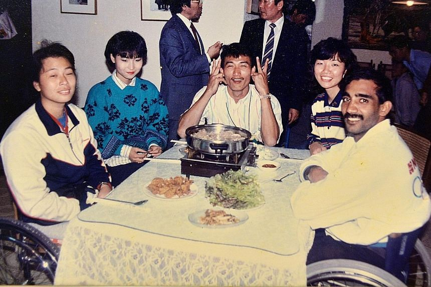 Singapore para-athletes Grace Ong Bah Lee (extreme left), Freddie Tang See Chong (middle) and Raja Singh dining out during the 1988 Seoul Paralympics, which marked the country's debut in the Games.
