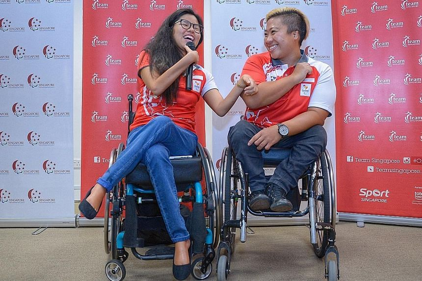 Above: Rio Paralympics medallists Yip Pin Xiu (left) and Theresa Goh sharing a light moment at a press conference yesterday. Left: Paralympic double gold medallist Yip showing her medals to her nieces Shernice Ang, four, and Chew Xiu Wen, 10, after a