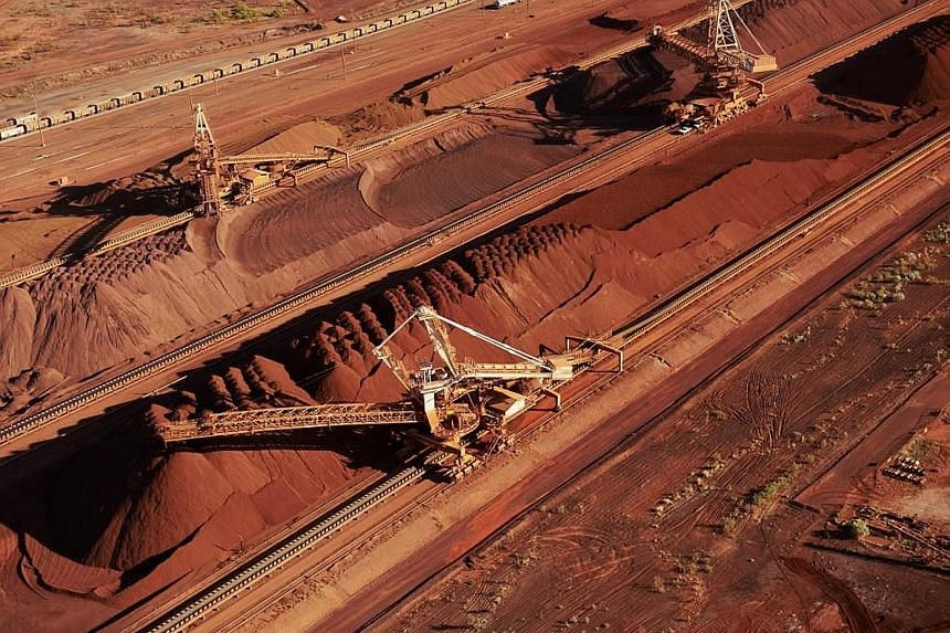 BHP Billiton's iron ore stockpiles. The Australian Tax Office says the miner needs to pay US$766 million (S$1.04 billion) in back taxes and charges for its Singapore commodities marketing hub.