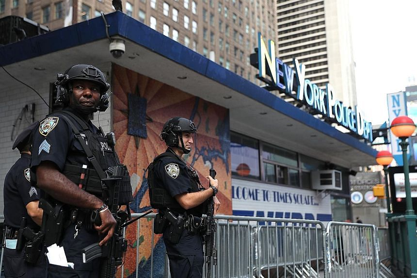 Police officers at Times Square in New York City on Tuesday. Security remains at a heightened level following the bombings.