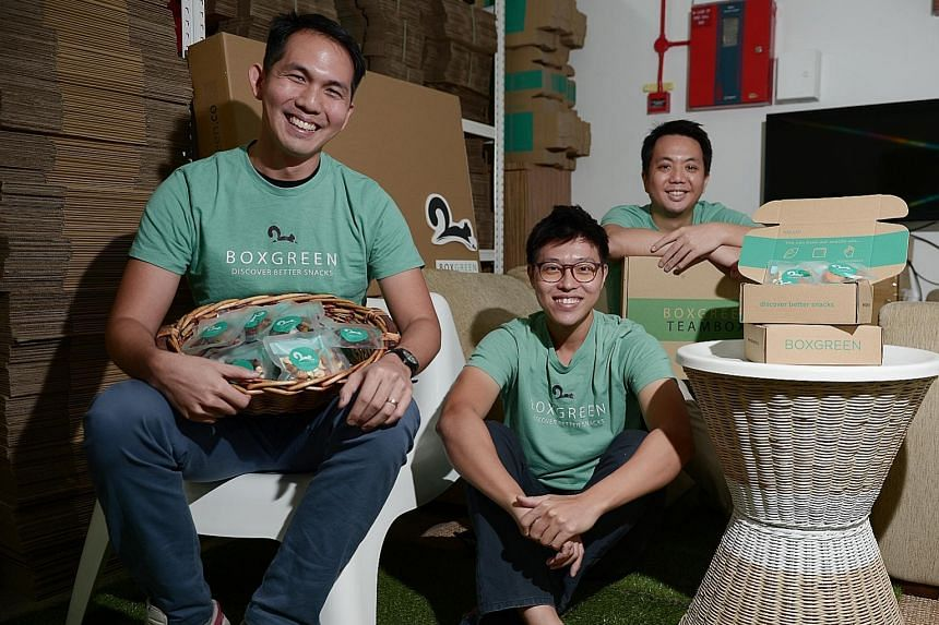 From left: Andrew Lim, 31, Walter Oh, 29, and Wong Weng Fai, 34, are the co-founders of BoxGreen, a start-up that runs a subscription service for healthy snacks. The trio has recently expanded their business to Malaysia and hopes to enter markets suc