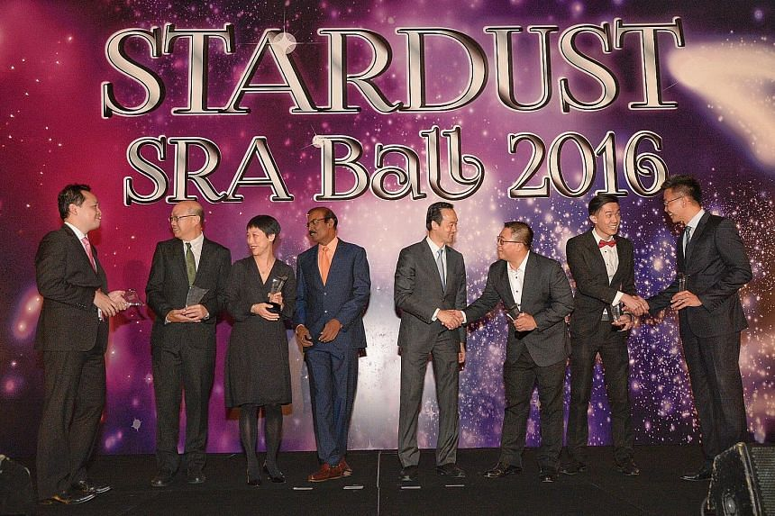 The six SRA retail awards were received by (from left) Changi Airport Group's Edwin Lim, for best retail event; NTUC Fairprice's Peter Teo, for best new entrant; DFS Venture Singapore's Wilcy Wong, for best retail concept; Mr Dhinakaran; Dr Koh; Sing