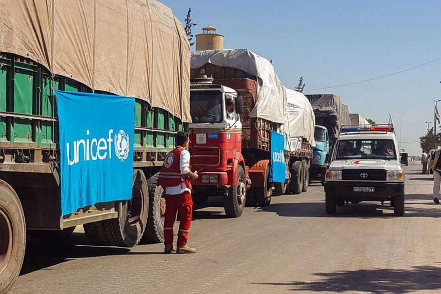 An aid convoy of 31 trucks prepares to set off to deliver aid to the western rural side of Aleppo, Syria, Sept 19, 2016.