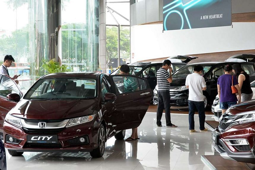 Potential buyers at the Kah Motor Singapore showroom on Feb 11.