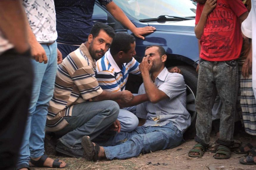 A relative of a missing person reacts as he waits for rescue workers in Rosetta on Sept 21, 2016.