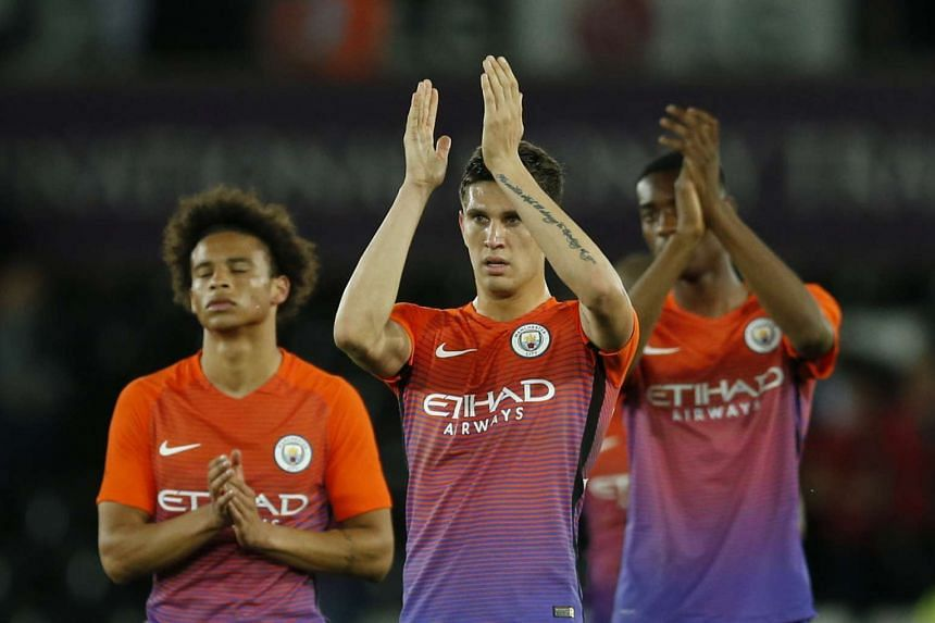 Manchester City's John Stones applauds fans after the game.
