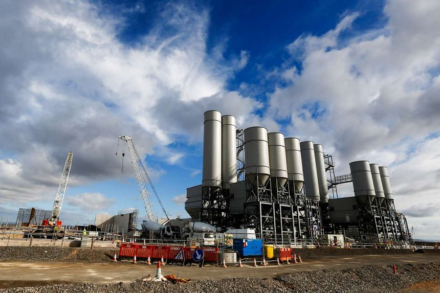 The concrete batching plant stands on the horizon as work recommences at the Hinkley Point C nuclear power station, operated by Electricite de France SA's (EDF), near Bridgwater, UK.
