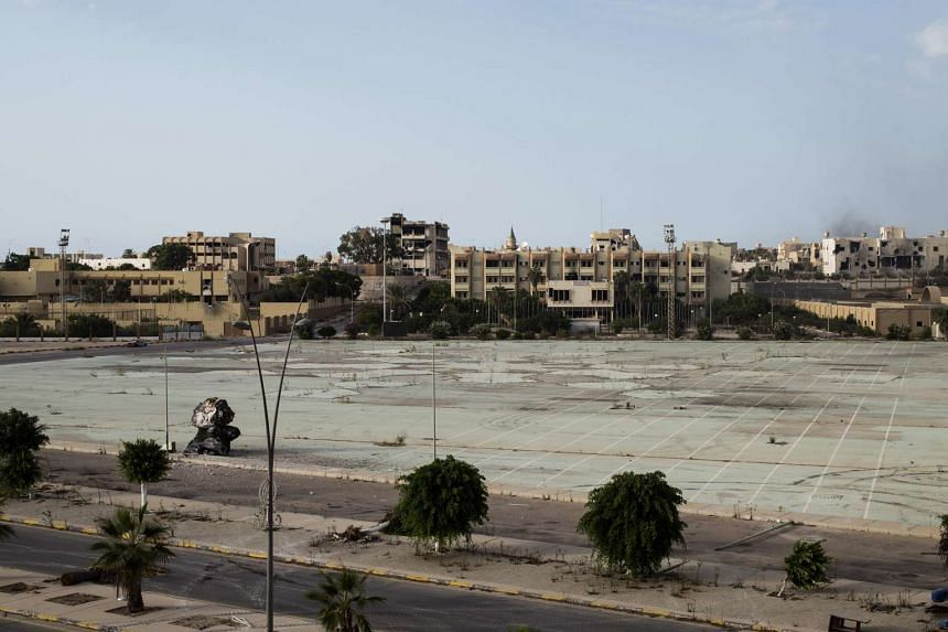 A landscape of destroyed buildings in Sirte. Forces discovered ISIS archives as they searched buildings seized during their battle to oust ISIS from its coastal bastion.