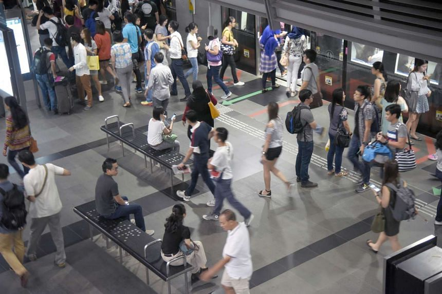 Commuters during rush hour at Paya Lebar MRT station on the Circle Line.