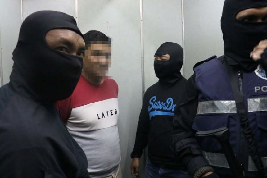 Counter-terror officers detaining the 38-year-old Nepalese businessman who was believed to handled the falsifying travel documents for terrorist groups.