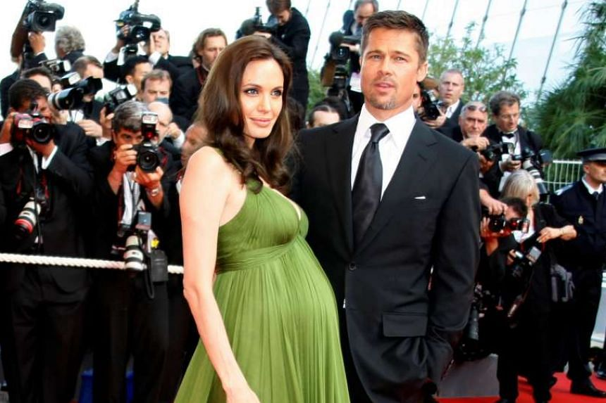 Jolie (pregnant with twins) and Pitt at the Cannes Film Festival in 2008.