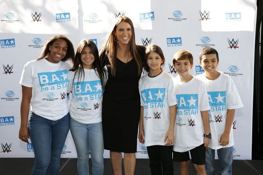 WWE's Stephanie McMahon with children from Be a Star, WWE's anti-bullying campaign.