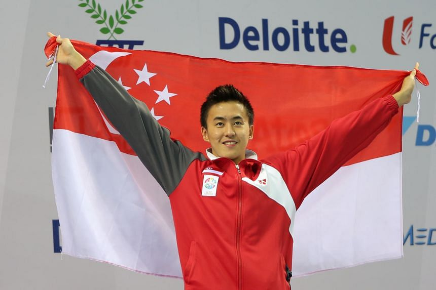 Quah Zheng Wen celebrates setting a new games record during the the men's 200m backstroke at the 28th Sea Games, on June 8, 2015.