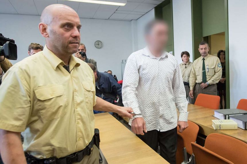 Montenegrin defendant's Vucelic V., accused of helping to prepare a terror attack after police found Kalashnikovs and explosives hidden in his car while he was driving to Paris last November, arrives at the courtroom of the Munich District Court with