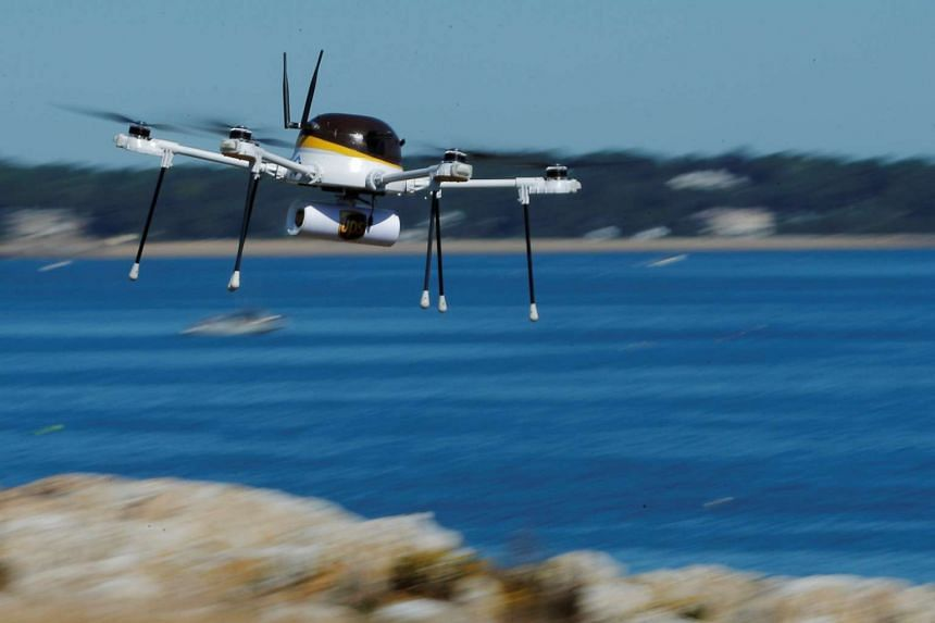 A drone, made by CyPhy Works, carries a UPS package on Children's Island off the coast of Beverly, Massachusetts on Sept 22, 2016.