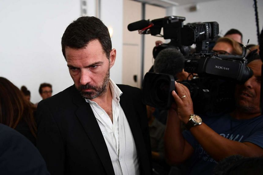 """French """"rogue trader"""" Jerome Kerviel arrives for his appeal trial at Versailles courthouse, outside Paris, on Sept 23, 2016."""