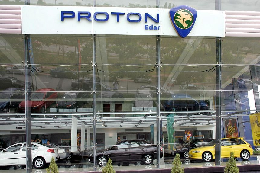 Proton cars wait for customers in a show room in Kuala Lumpur, Malaysia. Proton Holdings Bhd.