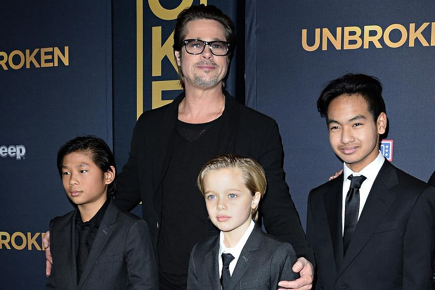 Brad Pitt and children Pax Jolie-Pitt (left), Shiloh Jolie-Pitt (centre) and Maddox Jolie-Pitt as they arrive for the US premiere of Unbroken on Dec 15, 2014.