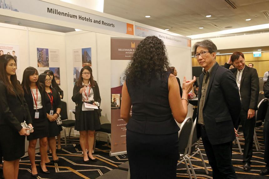 Minister for Manpower Lim Swee Say speaking to staff from participating hotels in the career fair at Hotel Day 2016 on Sept 23, 2016.