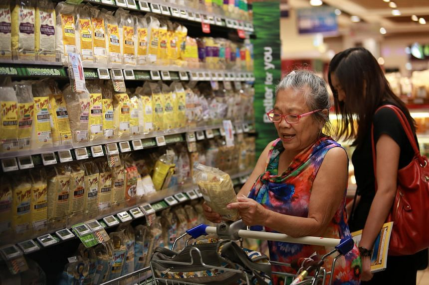 Shoppers at Cold Storage in Great World City.