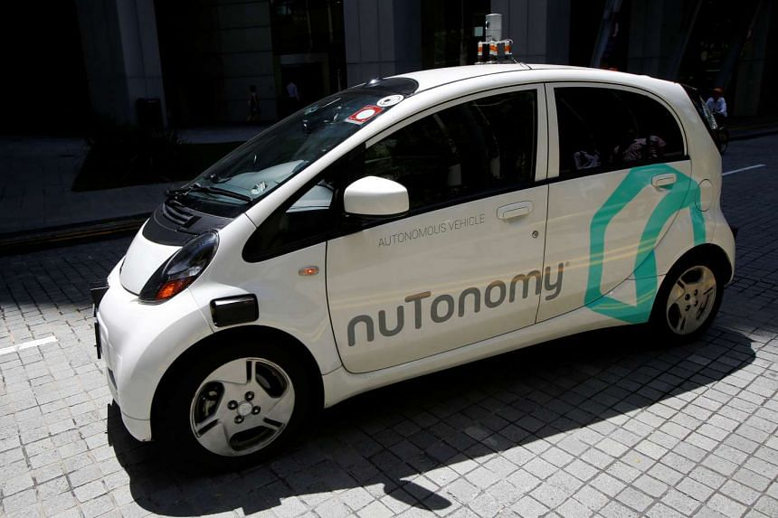 A nuTonomy self-driving taxi drives on the road in its public trial in Singapore on Aug 25, 2016.