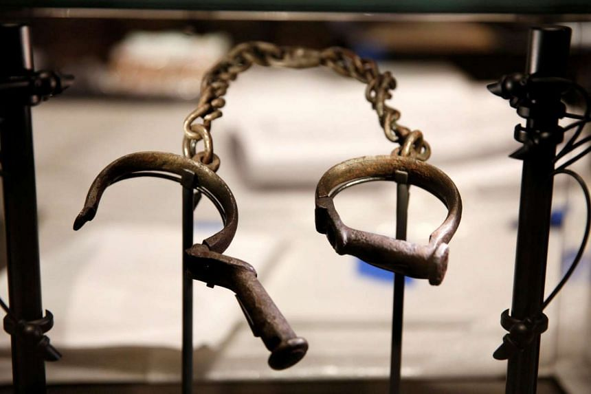 The town of Cacheu on the coast of Guinea-Bissau was a Portuguese trading post where millions of slaves saw west Africa for the last time, bound, branded and shipped off to the Americas. Slave shackles are seen here in a display case at the National