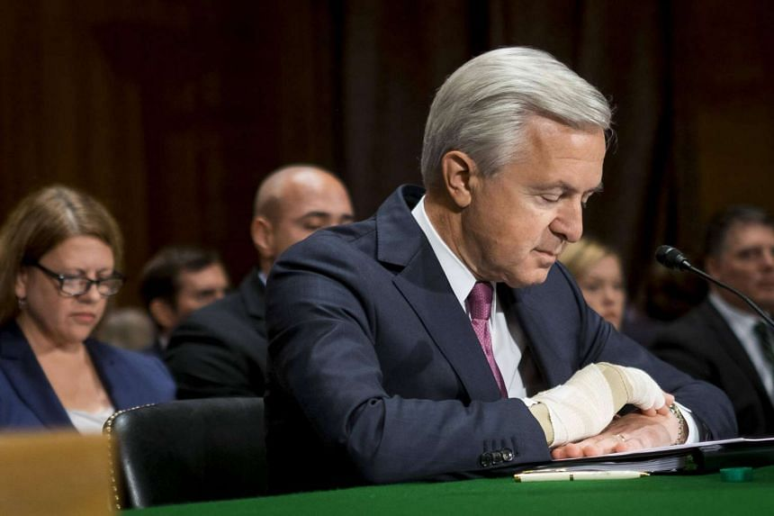 John Stumpf, chief executive officer of Wells Fargo & Co., prepares to testify before the Senate Committee on Banking, Housing, and Urban Affairs in Washington.