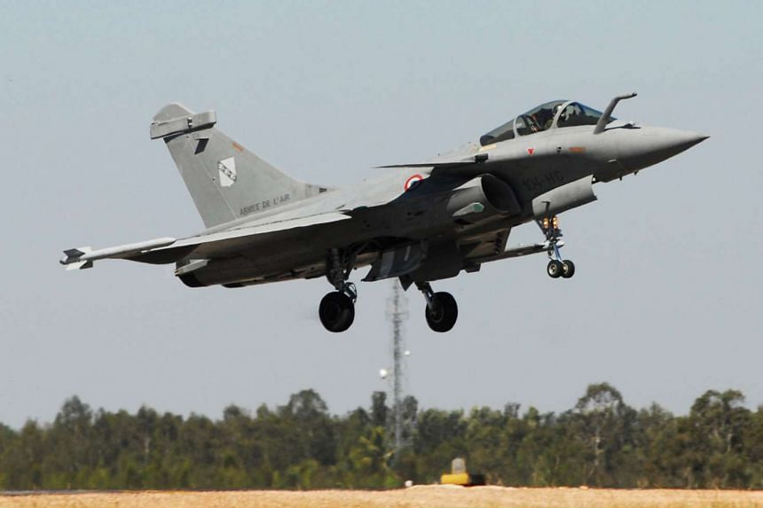 A file photo dated Feb 9, 2011, of a French 'Rafale' fighter jet performing during the inauguration of the Aero India-2011, in the southern Indian city of Bangalore, India.